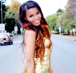 Khanya mkangisa glows in gold with two-toned curls