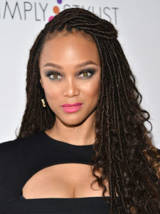 Tyra banks rocking Faux locs with Kinky hair