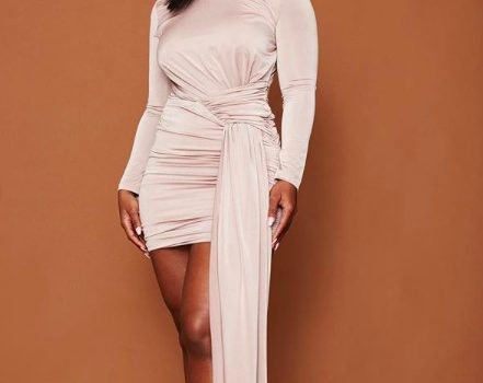 Boity wearing a dress with long straight weave