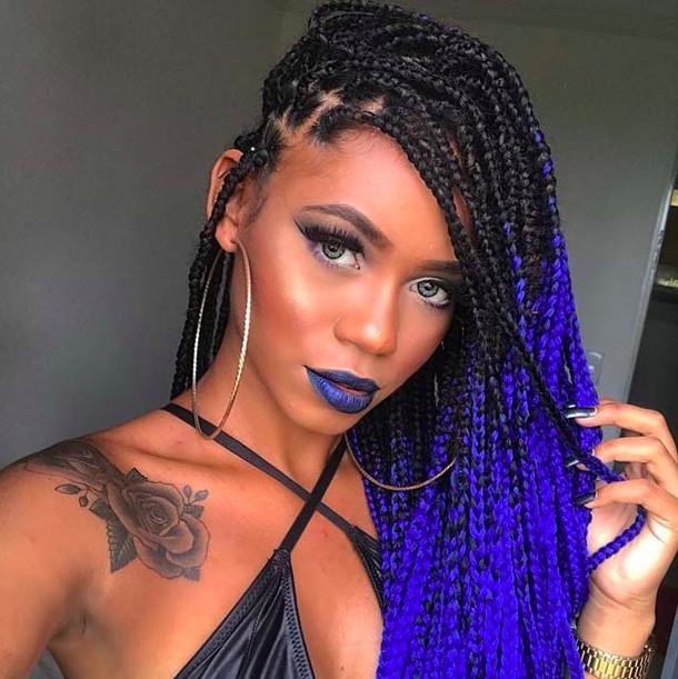 A person wearing a purple Carnival Braids
