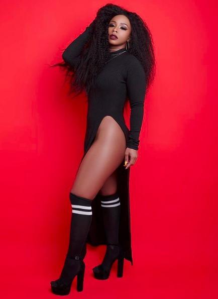 boity wearing a black dress a brazilian hair bundle