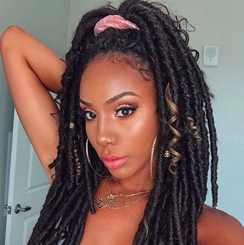 accessories for box braids in the hair of an African lady