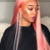 A close up of a person with pink Brazilian hair bundles