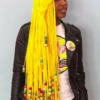 A person posing for the camera with beads braids accessories